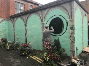 Artist Sym making a start on his part of the Wildwood Mural on Silver Street scaled