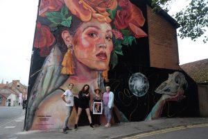 Curator Kim Artist Oksana Model Natasha and Sponsor JillMiddlewick. Globe Inn Mural