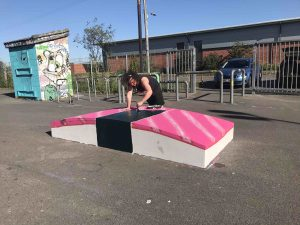 Dom Bell turns one of the skate obstacles into a giant sushi pre launch at the skatepark scaled