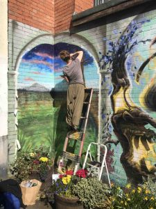 Forfitt working on her part of the wildwood mural scaled