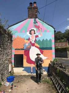 Frank stands with his almost finished mural on Chilkwell Street scaled