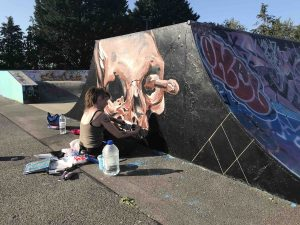 Jess Kaia working on her skull piece at Glastonbury skatepark on the morning of the launch scaled