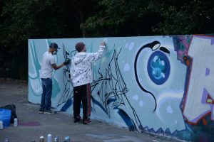 Jon Sikoh Sym painting the free wall at the skatepark