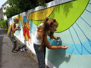 Kim Flo working on the winged bug on St Johns walk