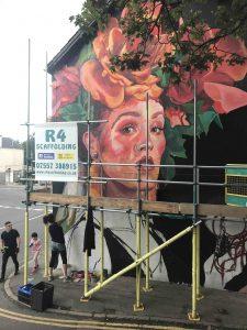 Oksana working on the Globe Inn Mural scaled