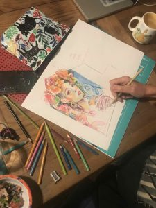 Oksana works on her mural design for the Globe Inn scaled