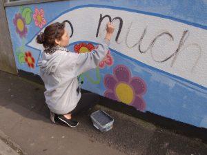 Sophie working on the sugar skull mural