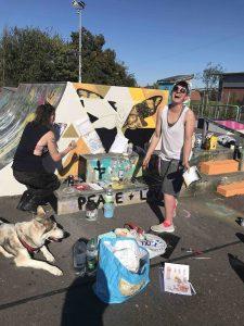 TOnia and Jess enjoying the sunshine whilst painting at Glastonbury skatepark scaled