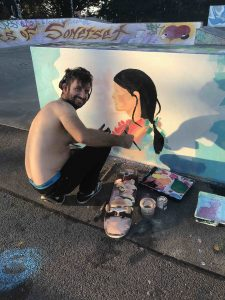 Theis Kotschi works on his portrat of a girl pre launch at the skatepark scaled
