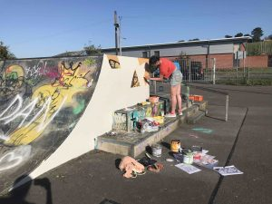 Tonia making a start on her moth mural for the launch at Glastonbury Skatepark scaled