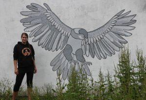 kim krumble and her harris hawk mural