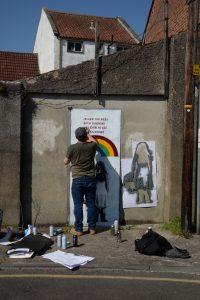 john Duh painting rainbows on Silver street door