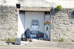 john doh painting nhs superheroes on silver street