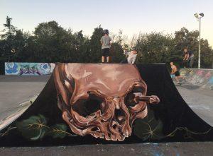 skull by Jess Kaia skate park mural trail launch 2019
